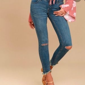 Frayed and distressed free people jeans